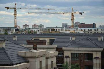 地產業半年業績榜出爐 龍頭房企降速 千億房企望再度擴容