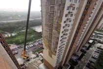 回應首開暢頤園外墻保溫層脫落 北京市住建委稱將嚴懲工程建設違法違規