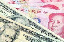 """人民幣對美元中間價""""破7"""" 離岸人民幣短線拉升超300點"""