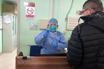 实地探访北京疫情防控第一线 基层医院增加医护人员驰援发热门诊