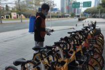 """美團單車倡議""""無接觸""""騎行,用戶遵循四準則:口罩手套、保持距離、騎前擦拭、騎完停好"""